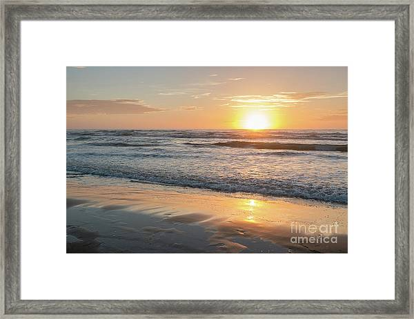 Rising Sun Reflecting On Wet Sand With Calm Ocean Waves In The B Framed Print