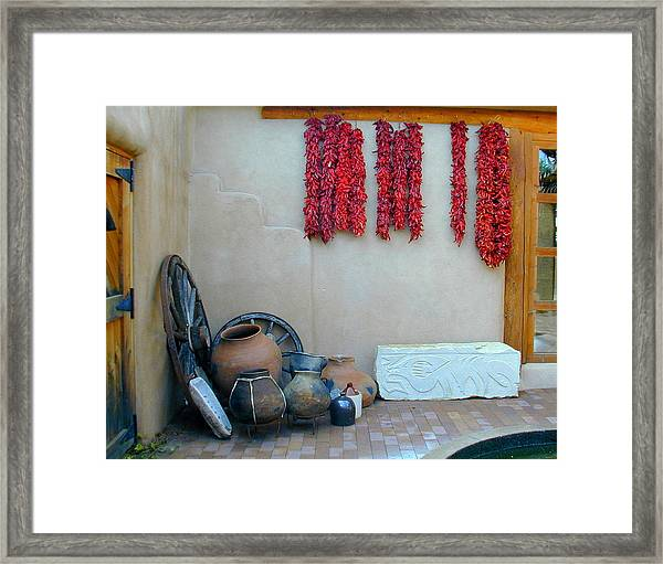 Framed Print featuring the photograph Ristras And Pots by Joseph R Luciano