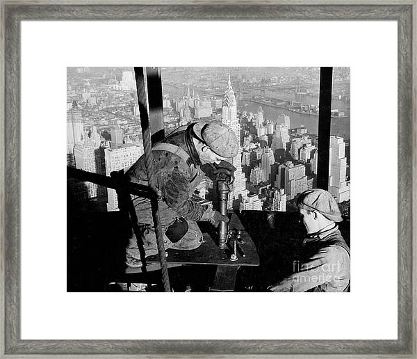 Riveters On The Empire State Building Framed Print