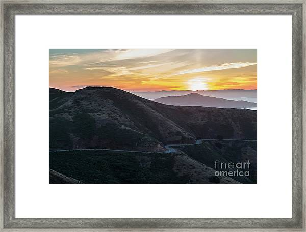 Road On The Edge Of The Mountain With Sunrise In The Background Framed Print