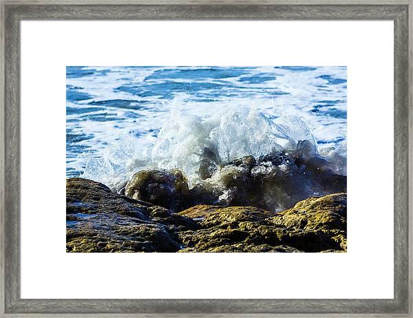 Wave Meets Rock Framed Print