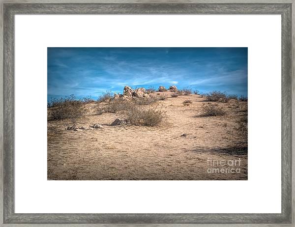 Rocks On The Hill Framed Print