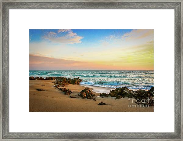 Framed Print featuring the photograph Rocky Beach by Tom Claud