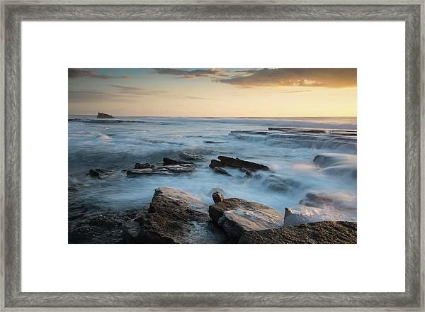 Rocky Seashore During Sunset Framed Print