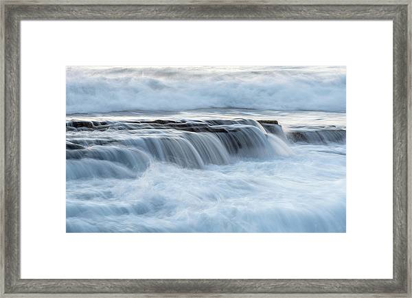 Rocky Seashore With Wavy Ocean And Waves Crashing On The Rocks  Framed Print