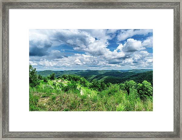 Rolling Hills And Puffy Clouds Framed Print