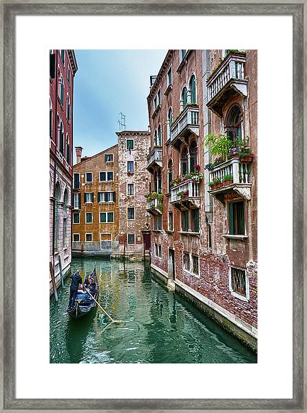 Gondola Ride Surrounded By Vintage Buildings In Venice, Italy Framed Print