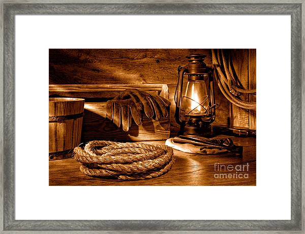 Rope And Tools In A Barn - Sepia Framed Print
