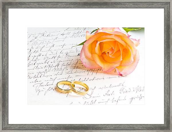 Rose And Two Rings Over Handwritten Letter Framed Print