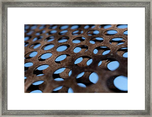 Rough Metal Abstract With Blue Holes In Green Bay Wisconsin Framed Print