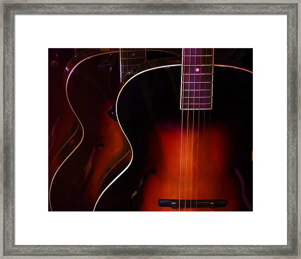 Row Of Guitars Framed Print
