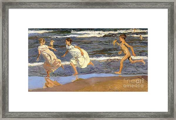 Running Along The Beach Framed Print