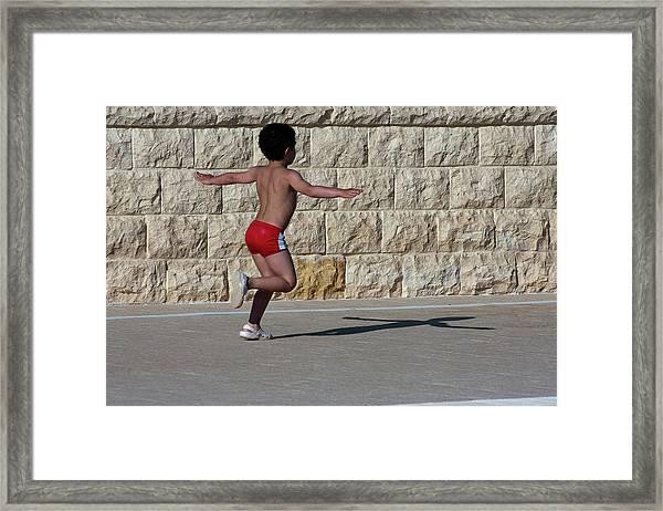Running Child Framed Print