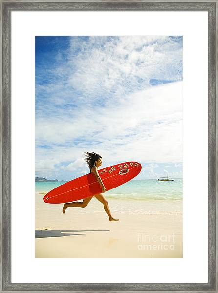 Running With Surfboard Framed Print