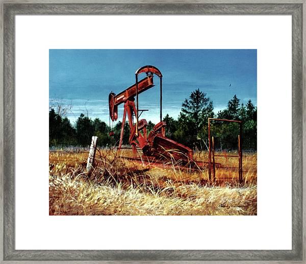 Rusty Pump Jack Framed Print