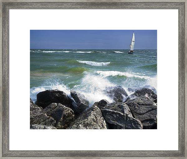 Sailboat Sailing Off The Shore At Ottawa Beach State Park Framed Print