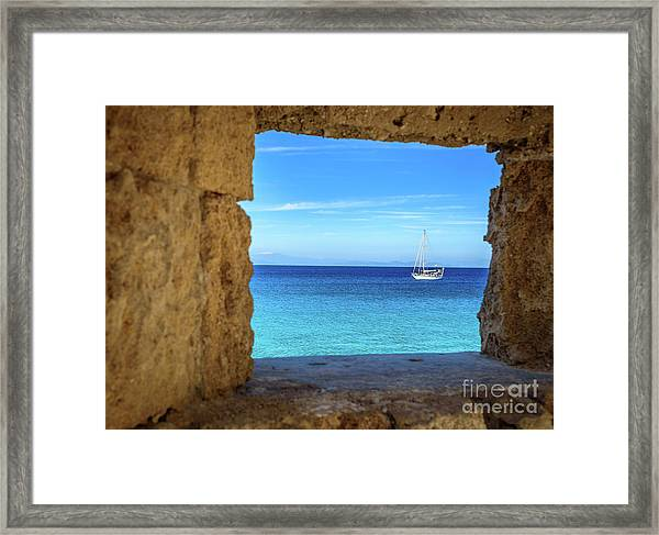 Sailboat Through The Old Stone Walls Of Rhodes, Greece Framed Print
