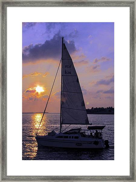 Framed Print featuring the photograph Sailing Home Sunset In Key West by Bob Slitzan
