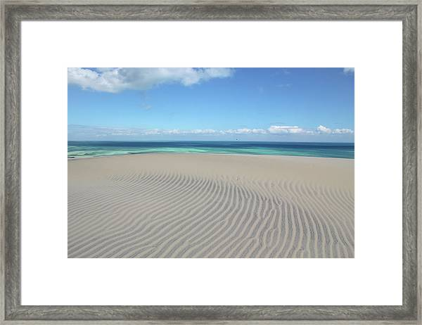 Sand Dune Ripples And The Ocean Beyond Framed Print