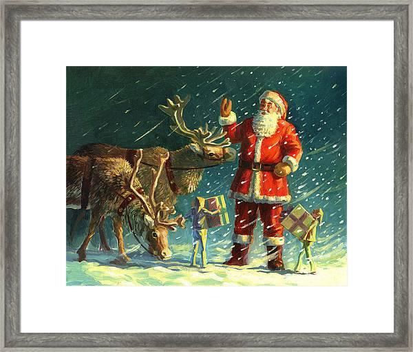Santas And Elves Framed Print