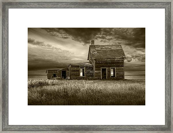 Sepia Tone Of Abandoned Prairie Farm House Framed Print