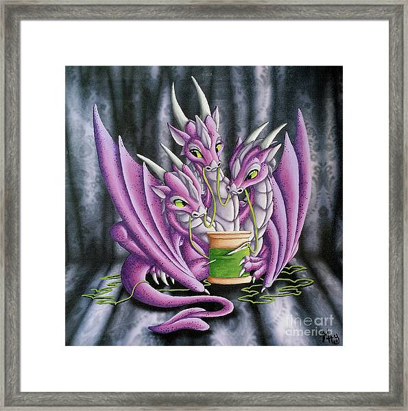 Sewing Dragons Framed Print