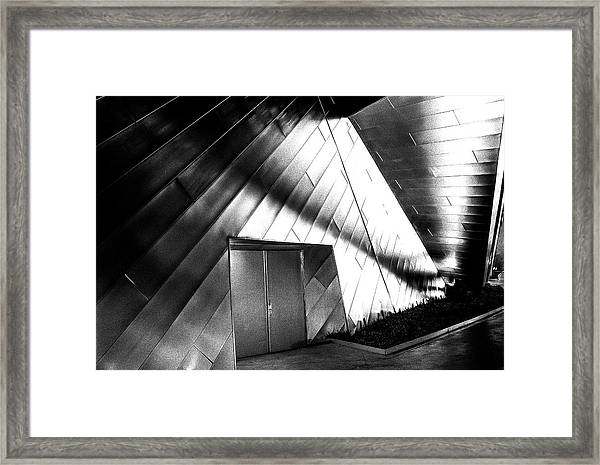 Shadows On The Wall Framed Print
