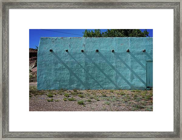Shadows On Turquoise Wall Framed Print