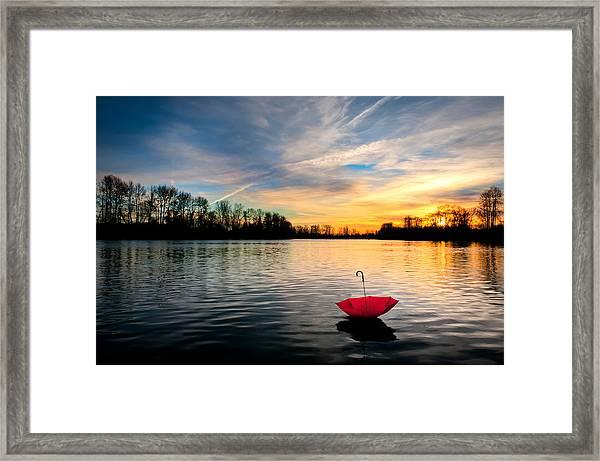 She Floats Away Framed Print