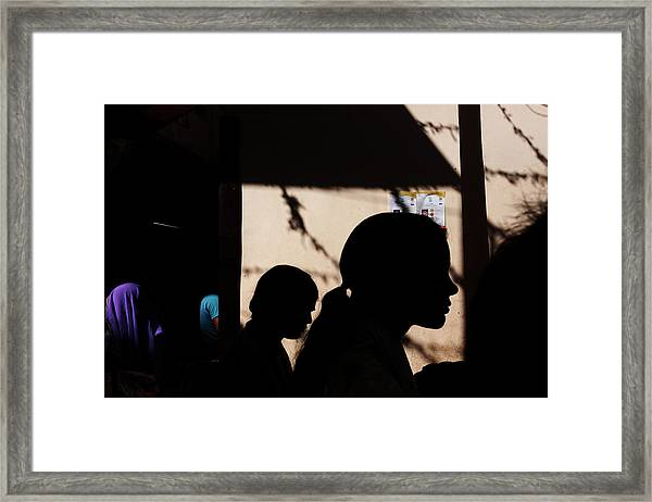 Silhouette Of People Framed Print