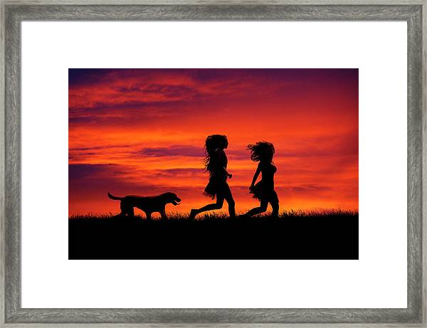 Silhouette Of Two Girls And Dog Framed Print