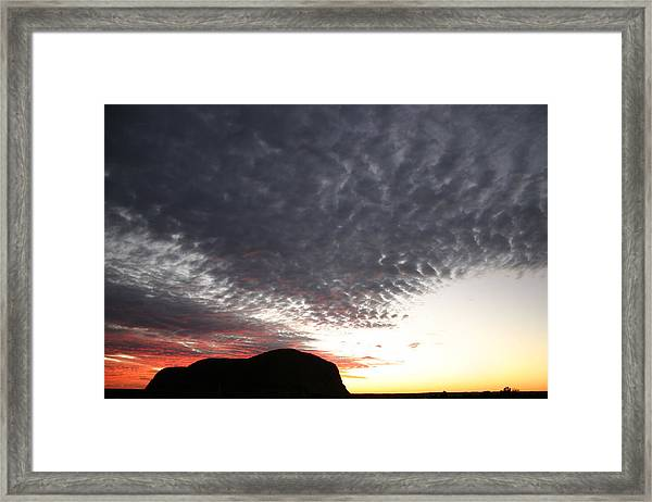 Silhouette Of Uluru At Sunset Framed Print