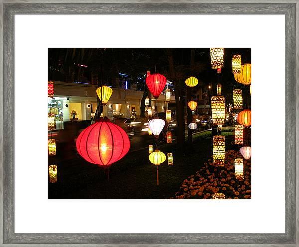Silk Lamp Shades On The Street In Saigon Framed Print