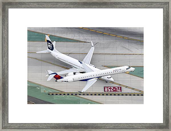 Simultaneous Airport Operation Framed Print