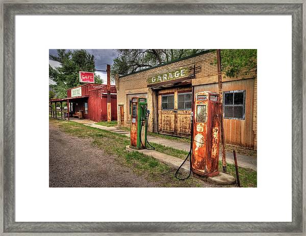 Sinclair Garage Framed Print