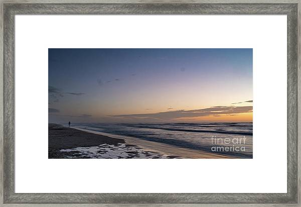 Single Man Walking On Beach With Sunset In The Background Framed Print