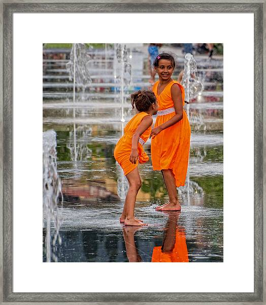 Sisters In The Waterpark Framed Print