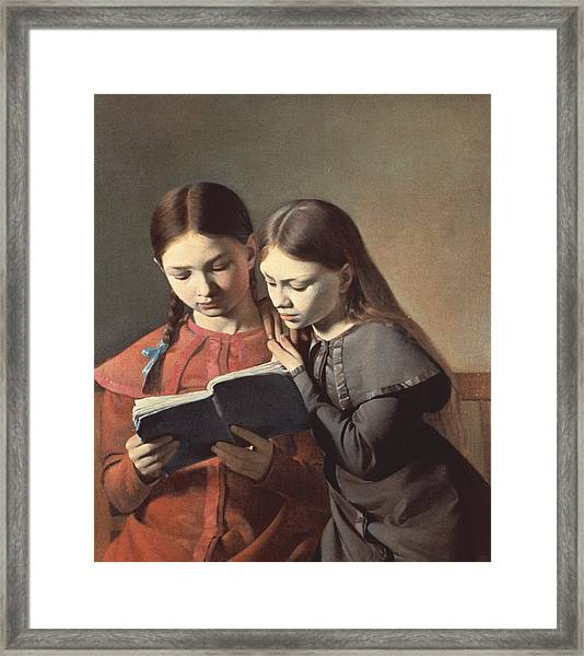 Sisters Reading A Book Framed Print