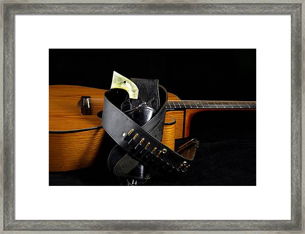 Six Gun And Guitar On Black Framed Print