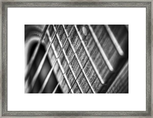 Six Strings Framed Print