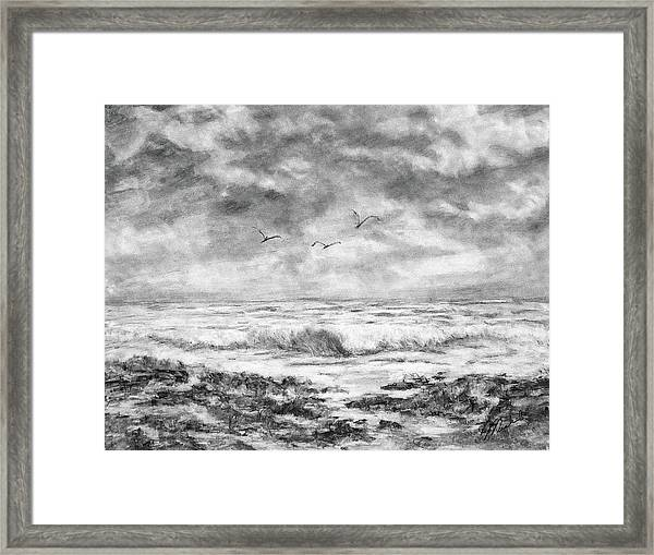 Sky Rocks And Water Framed Print