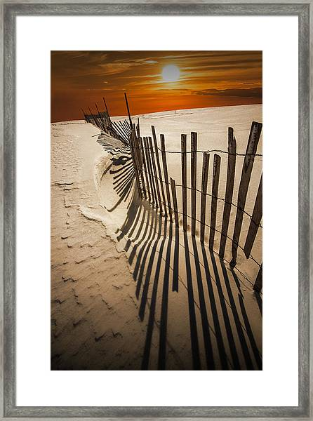 Snow Fence At Sunset Framed Print