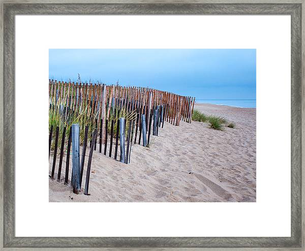 Snow Fence On The Beach Framed Print