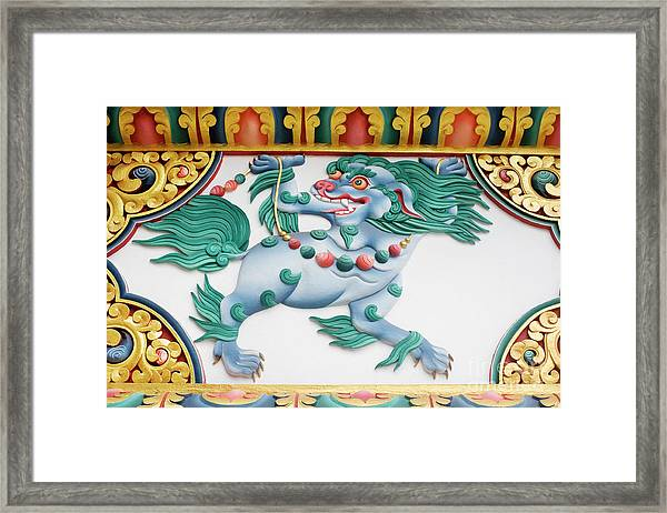 Snow Lion Framed Print