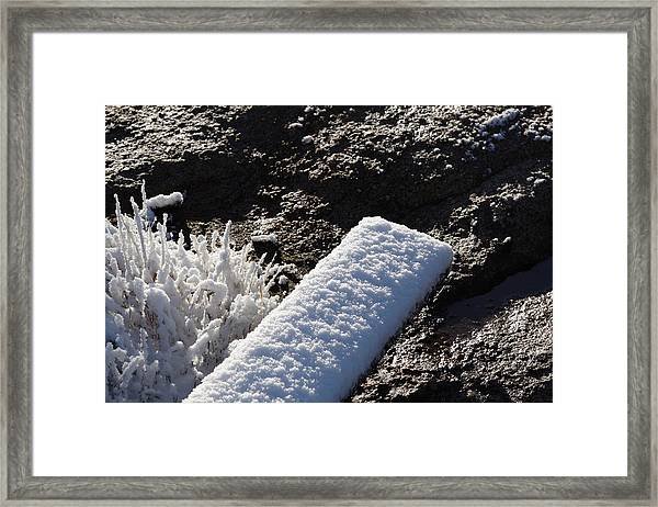 Snow On Plank With Rock Framed Print