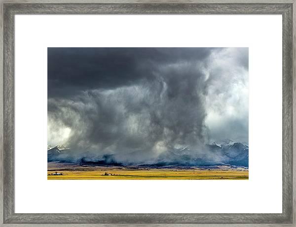 Snow On The Rockies Framed Print