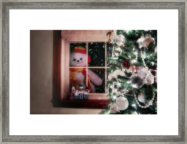 Snowman At The Window Framed Print