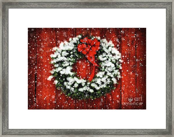 Framed Print featuring the photograph Snowy Christmas Wreath by Lois Bryan