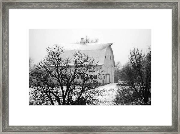 Snowy White Barn Framed Print