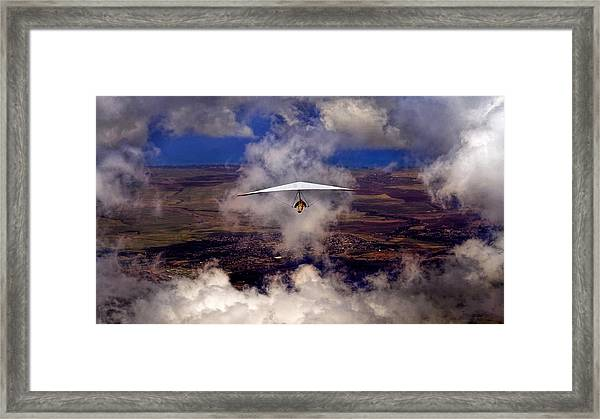Soaring Through The Clouds Framed Print